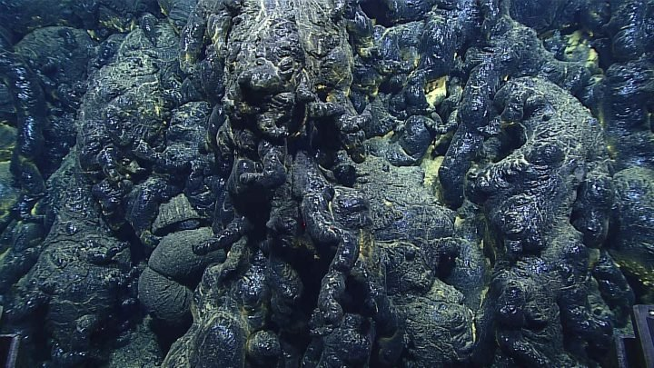 Very glassy lava flow less than three years old discovered in the Mariana back-arc. Photo by the remotely operated vehicle Deep Discoverer during dive EX1605L1-09 on 29-30 April 2016. Credit: Bill Chadwick, NOAA Exploration and Research Program and Pacific Marine Environmental Laboratory.