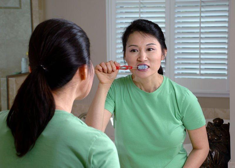 Fluoride, a diet low in sugar and starch, and vitamin D help in cavity prevention, but oral hygiene products without fluoride do not. Image credit: Bill Branson, National Cancer Institute (NCI), Public Domain