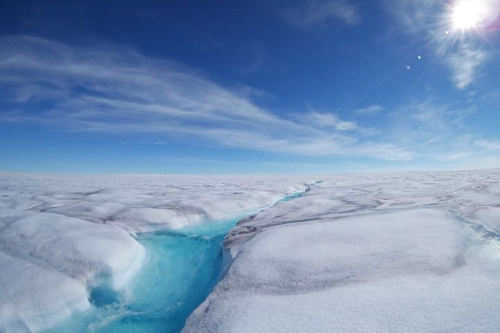 A fast-flowing meltwater stream in Store Glacier, Greenland. New observation of liquid water stored within solid ice may explain the complex flow behavior of some Greenland glaciers. Image credit: Sean Peters / Stanford University