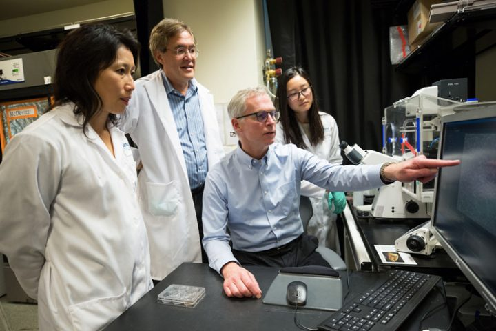 Jim Johnsen, seated, meets with Po-Lin So, Bruce Conklin and Angela Liu at the Gladstone Institutes to discuss his rare eye disease. (UCSF photo)