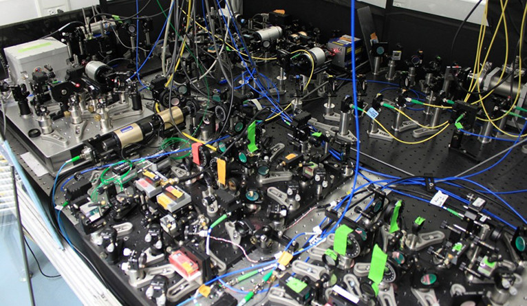 Some of the lasers and optics used in the ACME experiment. (Photo credit: Loic Anderegg / Yale University)