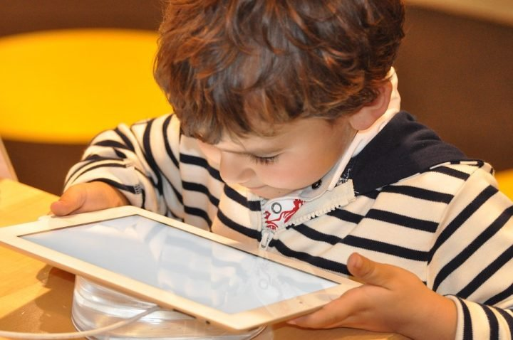 A kid with a tablet computer. Image credit: NadineDoerle via Pixabay, CC0 Public Domain