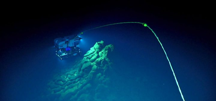 The remotely operated vehicle Deep Discoverer explores a conical eruptive center at the top of one of the newly discovered lava flows in the Mariana back-arc. Photo during dive EX1605L1-09 on 29-30 April 2016. Credit: Bill Chadwick, NOAA Exploration and Research Program and Pacific Marine Environmental Laboratory.