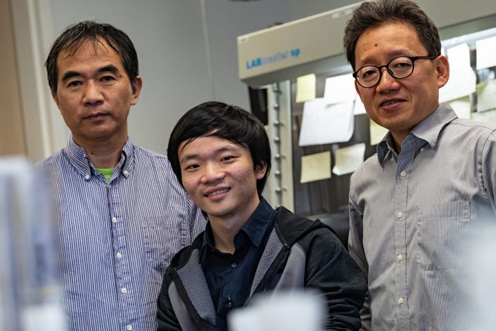 A team of physicists including (from left) Pengcheng Dai, Lebing Chen and Jae-Ho Chung has found the first evidence of a two-dimensional material that can become a magnetic topological insulator even when it is not placed in a magnetic field. (Photo by Jeff Fitlow/Rice University)