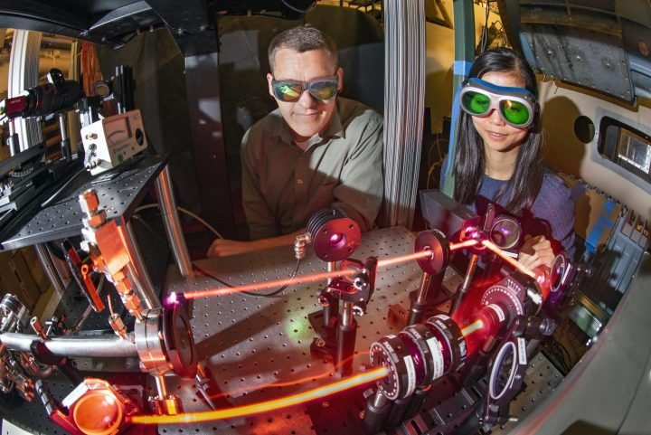 Daniel Richardson, left, a mechanical engineer in Sandia National Laboratories' diagnostic sciences, and Yibin Zhang, a postdoctoral fellow, observe a laser that records measurements in the hypersonic wind tunnel. (Photo by Randy Montoya)