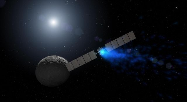 This artist's rendering shows NASA's Dawn spacecraft maneuvering above Ceres with its ion propulsion system. Image credit: NASA/JPL