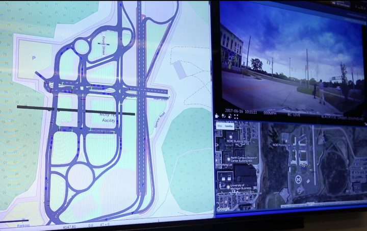 Virtual connected vehicles (blue) can be seen traveling at Mcity alongside real connected and automated vehicles (red). This unique type of augmented reality can dramatically accelerate testing of connected and automated vehicles and enable researchers to test scenarios in a safer, more cost-effective manner. Image credit: Screen capture from a video by Mike Wood, University of Michigan