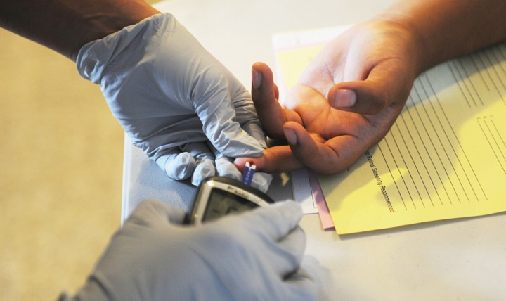A doctor performs a glucose screening. A person diagnosed with diabetes is lacking insulin or is insulin resistant so that the body can't process sugars normally. Image credit: U.S. Army / Jessica A DuVernay, Public Domain