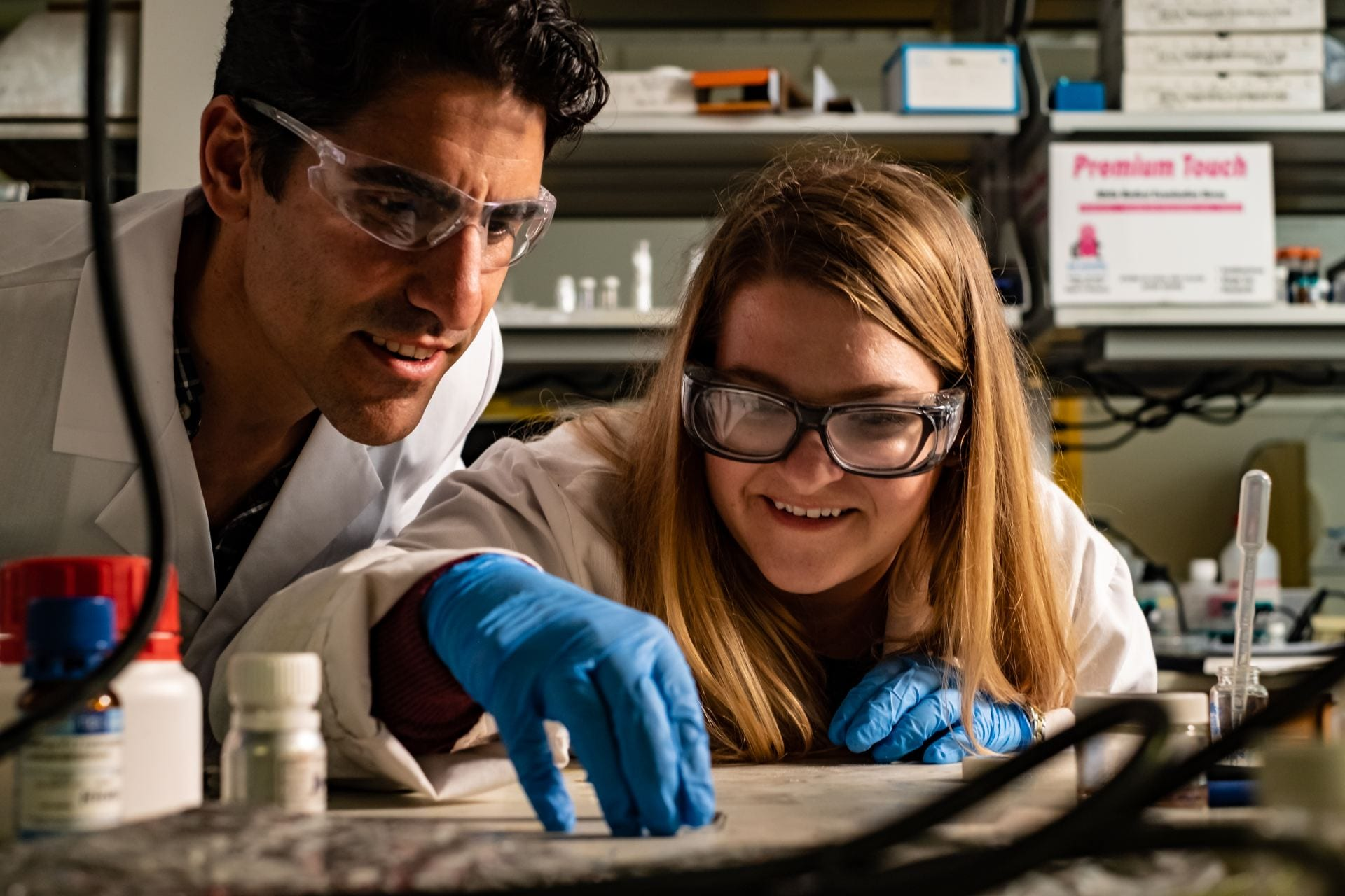 Rice University materials scientist Rafael Verduzco and graduate student Morgan Barnes check a sample while working on shape-shifting polymers. They have created a liquid crystal elastomer that can be molded into shapes that shift from one to another when heated. (Credit: Jeff Fitlow/Rice University)