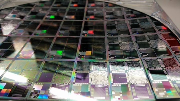 A photograph of a 12-inch wafer of microelectronic testbeds. Image credit: DrHughManning via Wikimedia, CC-BY-SA-4.0