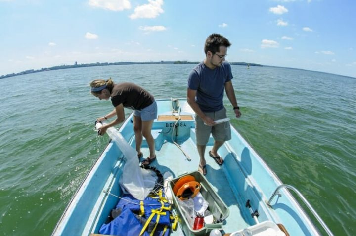 Jake Walsh (right), a researcher for the Center for Limnology, and undergraduate Carly Broshat use plankton nets to collect water samples from Lake Mendota in July 2012. Photo: Bryce Richter / University of Wisconsin-Madison