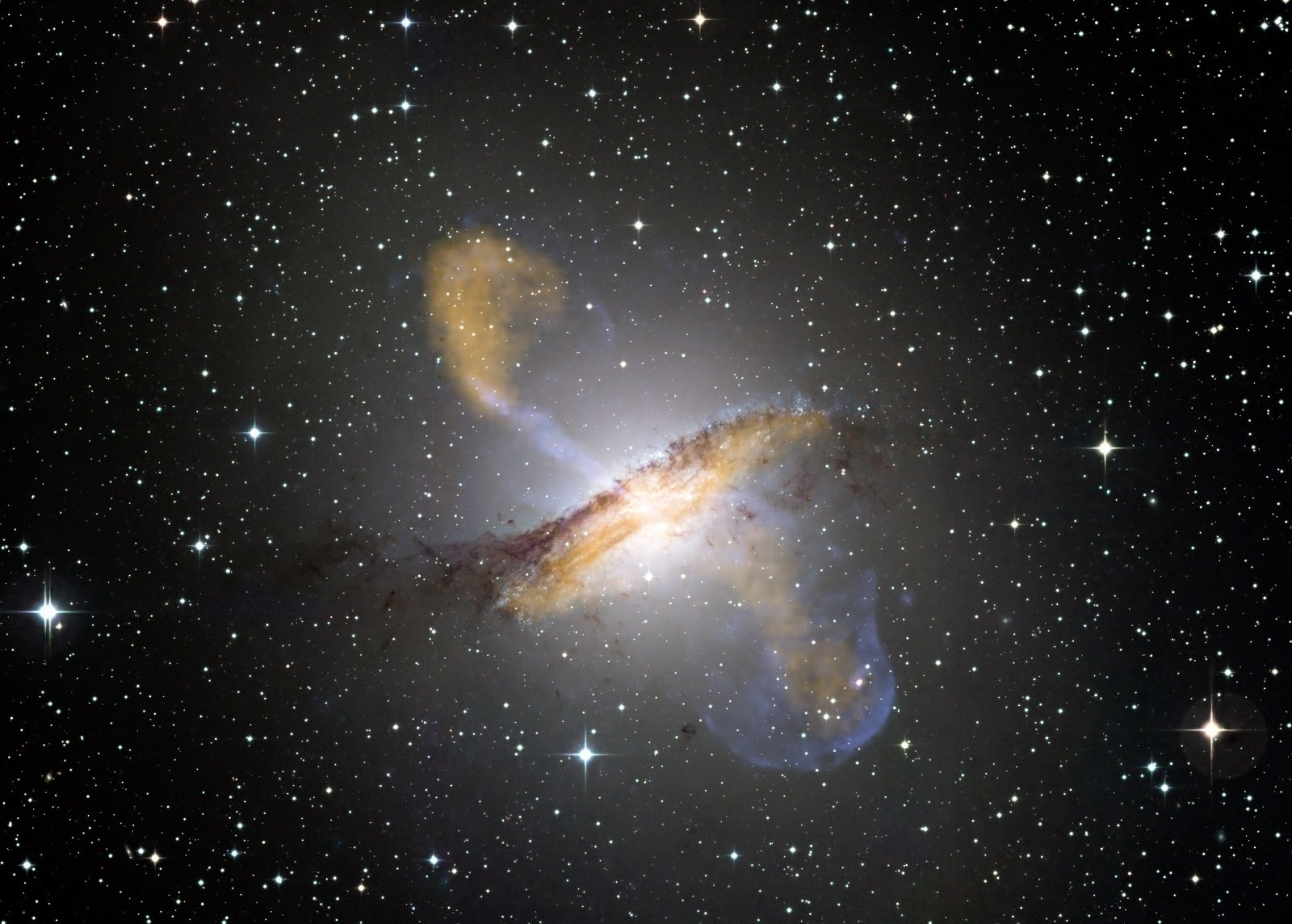 Composite image of the active galaxy Centaurus A, showing lobes and jets extending millions of light years into space. (Optical: ESO/WFI; Submillimeter: MPIfR/ESO/APEX/A.Weiss et al.; X-ray: NASA/CXC/CfA/R.Kraft et al.)