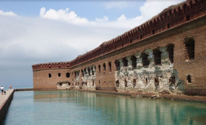 A new study details risks from a rapidly changing environment, including increased natural disasters. Pictured: Climate-related damage on an exterior wall of Fort Jefferson at Dry Tortugas National Park. Image credit: NPS/M. Rockman, Public Domain