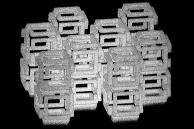 MIT engineers have devised a way to create 3-D nanoscale objects by patterning a larger structure with a laser and then shrinking it. This image shows a complex structure prior to shrinking. Image credit: Daniel Oran