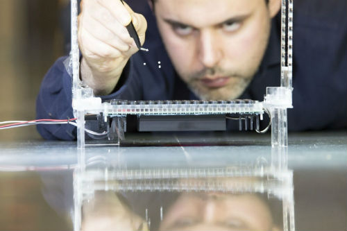 Researcher testing the acoustic traps generated by the Holographic Acoustic Tweezers. Image credit: Sergio Larripa, Asier Marzo, Bruce Drinkwater