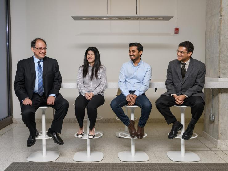 From left to right: Manos Tentzeris, the Ken Byers Professor in Flexible Electronics in the Georgia Tech School of Electrical and Computer Engineering, Larissa Novelino, a Georgia Tech graduate student, Abdullah Nauroze, a Georgia Tech graduate student, Glaucio Paulino, the Raymond Allen Jones Chair of Engineering and a professor in the Georgia Tech School of Civil and Environmental Engineering (Credit: Rob Felt, Georgia Tech)