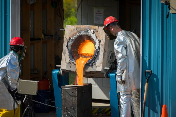 Researchers pour lava from the furnace after the melt is complete. The furnace is located at the University at Buffalo's Geohazards Field Station in Upstate New York. Credit: Douglas Levere / University at Buffalo