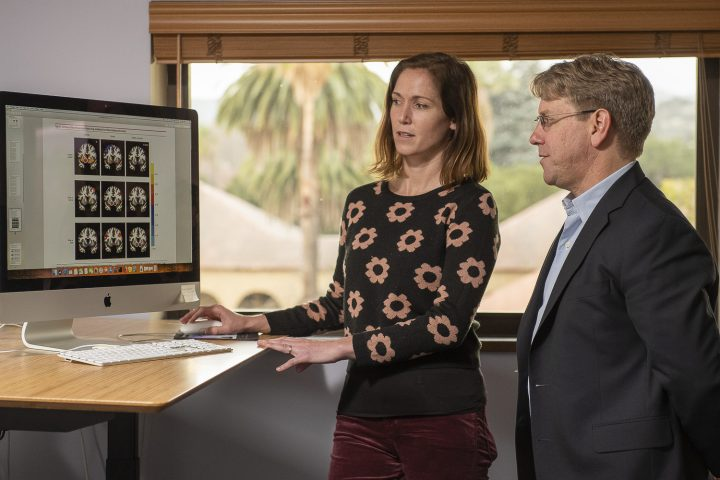 Kelly MacNiven and Brian Knutson discuss brain scans that are featured in the paper. Kelly MacNiven, Brian Knutson and colleagues identified a way to predict drug relapse using brain scans. (Image credit: L.A. Cicero, Stanford University)