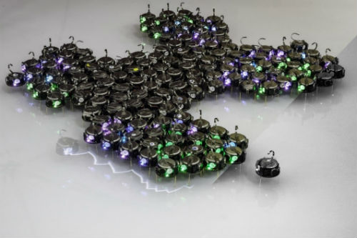 The robots used during the experiments. The shape of this particular swarm is a hand-made illustration of the technique. Image credit: AAAS / University of Bristol