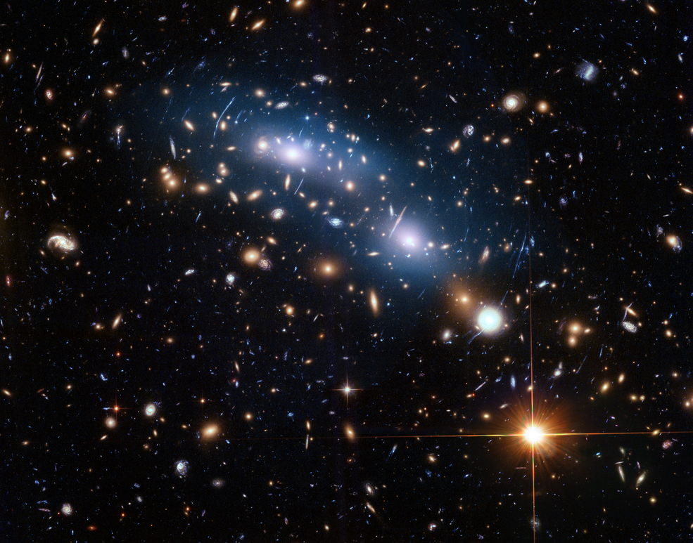 Amid the bright light of its member galaxies, the galaxy cluster MACS J0416.1-2403 also emits a soft glow of intracluster light, produced by stars that are not part of any individual galaxy. These stars were scattered throughout the cluster long ago, when their home galaxies were torn apart by the cluster's gravitational forces. The homeless stars eventually aligned themselves with the gravity of the overall cluster. Hubble's unique sensitivity and resolution captures the faint light and uses it to trace the location of invisible dark matter, which dominates the cluster's gravitational field. Credits: NASA, ESA and M. Montes (University of New South Wales)