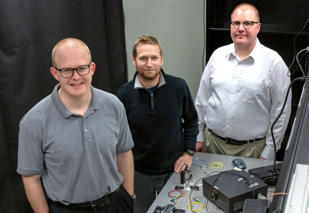 Joseph Lukens, Raphael Pooser, and Nick Peters (from left) of ORNL's Quantum Information Science Group developed and tested a new interferometer made from highly nonlinear fiber in pursuit of improved sensitivity at the quantum scale. Credit: Carlos Jones/ORNL