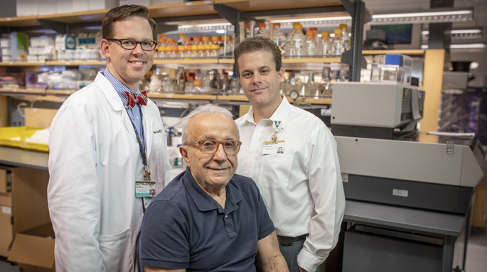 Vance Albaugh, MD, PhD, left, Robb Flynn, PhD, and Naji Abumrad, MD, seated, are studying how weight-loss operations cause positive metabolic effects, even before weight loss happens. (photo by John Russell/Vanderbilt University)