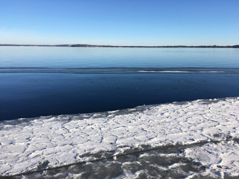 People ice skate on Lake Mendota on Jan. 16, 2019. The lake froze on Dec. 15, 2018, reopened on Dec. 21, 2018, and then froze again on Jan. 10, 2019. Northern lakes are experiencing fewer frozen days and are likely to experience more ice-free winters as the climate warms. Illustration by Kelly April Tyrrell / University of Wisconsin-Madison