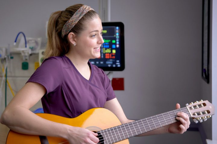 "Ciele Gutierrez offers music therapy by singing or strumming a guitar. ""I provide A cappella singing music,"" she said. ""We use lullabies in the NICU because they are not complex, they're repetitive, easy to listen to, and they're already promoting language development."" Image credit: Tallahassee Memorial HealthCare"