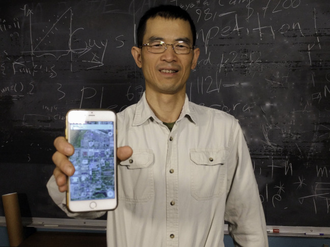 Ying Cai says his cloaking technology can conceal your precise location when using apps on your mobile phone. Image credit: Dave Olson / Iowa State University