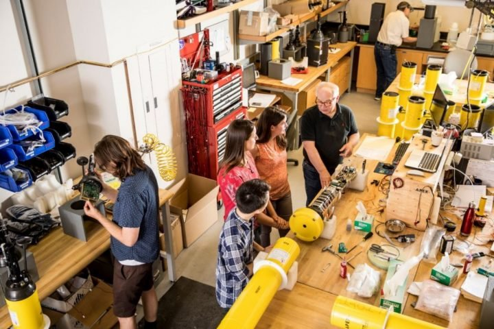 Steve Riser (center, in black), students and technicians in July 2017 inside the UW School of Oceanography's floats lab. Image credit: Dennis Wise/University of Washington