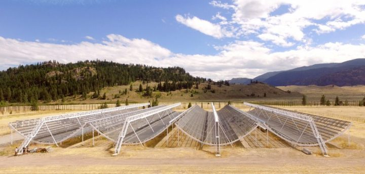 The CHIME telescope incorporates four 100-metre long U-shaped cylinders of metal mesh that resemble snowboard half-pipes, with total area equivalent to five hockey rinks. CHIME reconstructs the image of the overhead sky by processing the radio signals recorded by over a thousand antennas. Its signal processing system is the largest of any telescope on Earth, allowing it to search huge regions of the sky simultaneously. (Credit: CHIME)