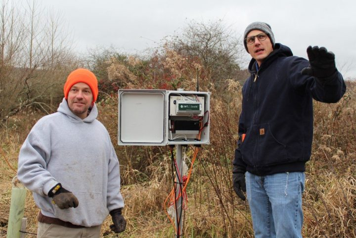 Daniel McLaughlin, left, and Matthew Fisher discuss the 1 kilometer distance for communication between the environmental sensing system's node network and gateway.