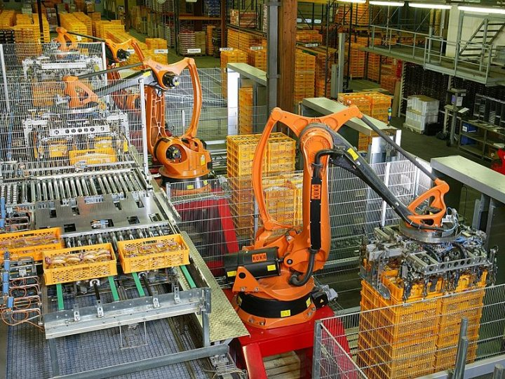 Factory automation with industrial robots for palletizing food products like bread and toast at a bakery in Germany. Image credit: KUKA Roboter GmbH, Bachmann (Public Domain via Wikimedia)