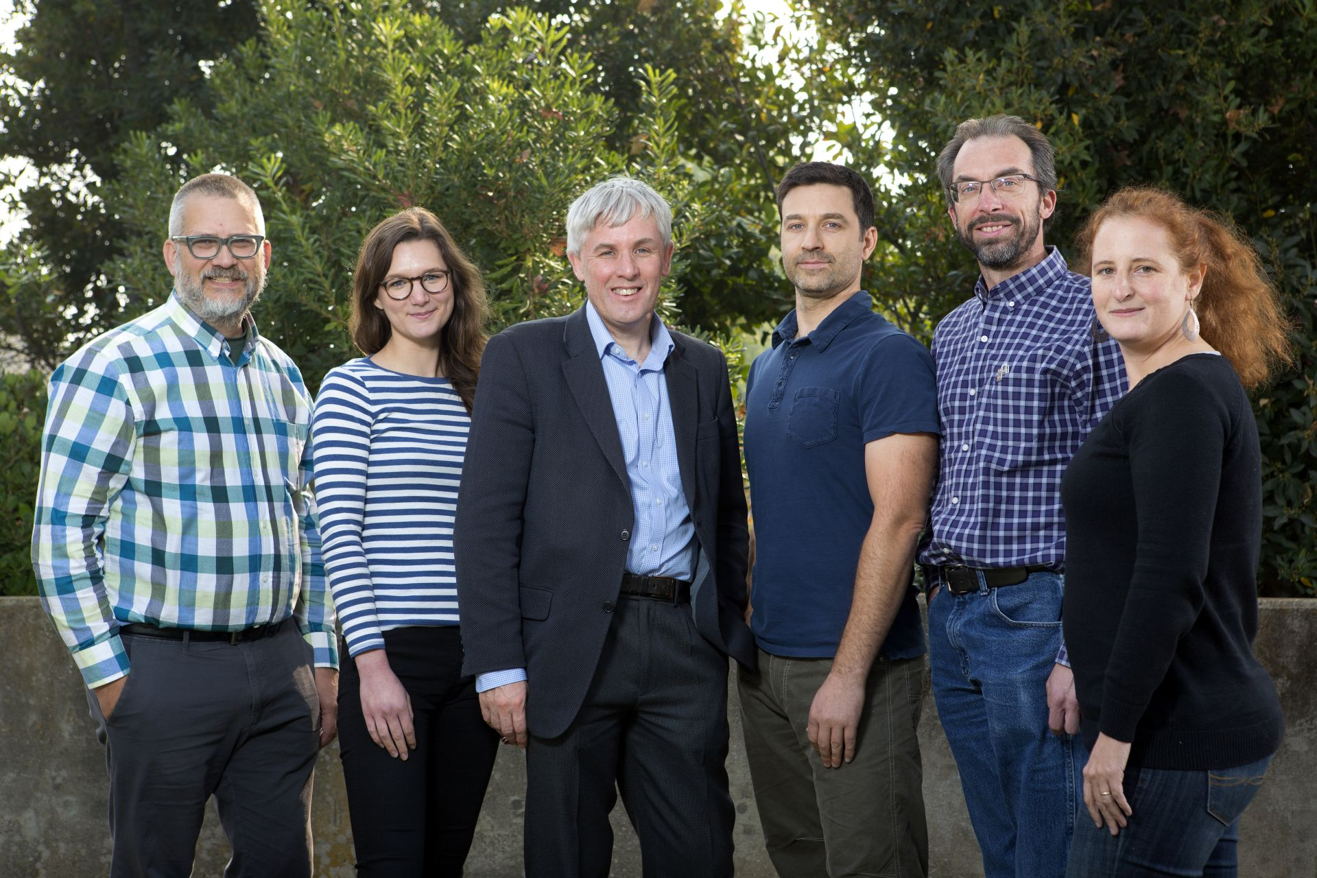 Professor of Atmospheric Chemistry at the University of Leeds Dwayne Heard, third from left, recently visited Sandia National Laboratories' Combustion Research Center. From left, Craig Taatjes, Rebecca Caravan, Heard, Lenny Sheps, David Osborn and Judit Zador. (Photo by Dino Vournas/Sandia)