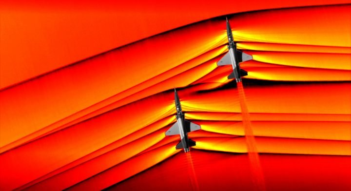 Using the schlieren photography technique, NASA was able to capture the first air-to-air images of the interaction of shockwaves from two supersonic aircraft flying in formation. These two U.S. Air Force Test Pilot School T-38 aircraft are flying in formation, approximately 30 feet apart, at supersonic speeds, or faster than the speed of sound, producing shockwaves that are typically heard on the ground as a sonic boom. The images, originally monochromatic and shown here as colorized composite images, were captured during a supersonic flight series flown, in part, to better understand how shocks interact with aircraft plumes, as well as with each other. Credits: NASA