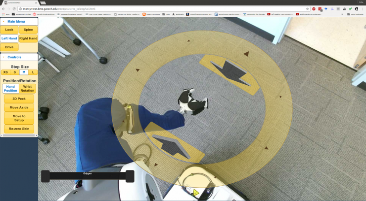 Image shows the view through the PR2's cameras showing the environment around the robot. Clicking the yellow disc allows users the control the arm. (Credit: Phillip Grice, Georgia Tech)