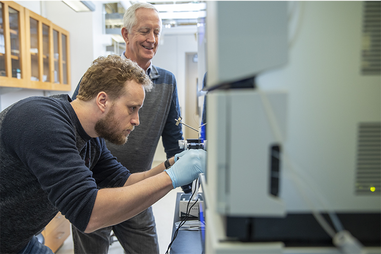 Vierstra (center) works with postdoctoral research associate Fionn McLoughlin (left) at his laboratory in McDonnell Hall. (Photo: Whitney Curtis/Washington University)