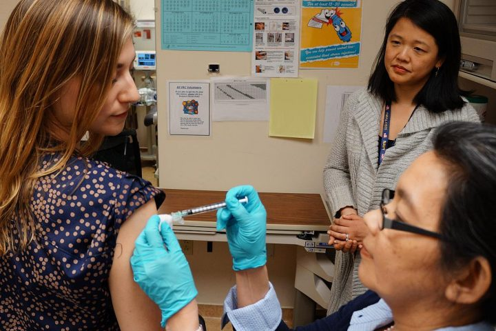 A healthy volunteer receives an experimental universal influenza vaccine known as H1ssF_3928 as part of a Phase 1 clinical trial at the NIH Clinical Center in Bethesda, Maryland. Scientists at NIAID's Vaccine Research Center (VRC) developed the vaccine. Image credit: NIAID