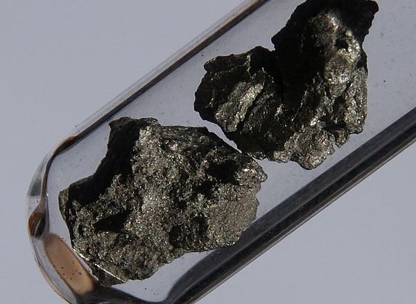 Zirconium is a hard, silvery grey metal. It is quite reactive, but forms a protective oxide layer in air, which makes it corrosion-resistant. Above all, it is used for special alloys. From cubic zirconia, ZrO2, artificial gemstones can be made, which look very similar to diamonds. Image credit: images-of-elements.com, CC BY 3.0