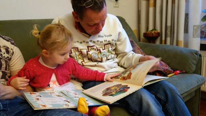 Reading to a child. Image credit: Max Pixel, CC0 Public Domain