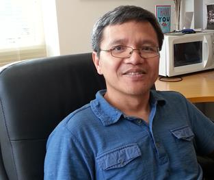 Wu-Min Deng, professor of biological science