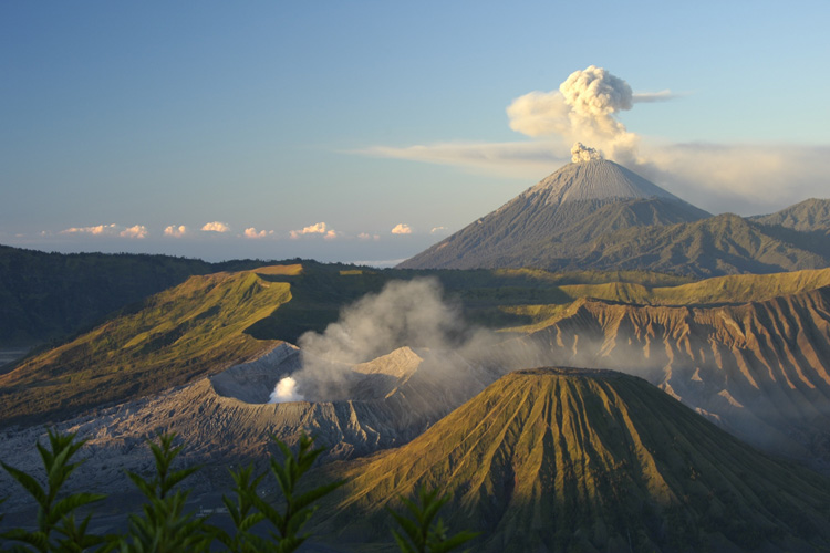 Mt. Bromo on the island of Java, Indonesia. An ongoing collision between a continental plate and this arc of volcanic islands is exposing rocks that take up carbon dioxide from the atmosphere, which tends to cool Earth. In earlier eras, such collisions in the tropics led to global ice ages. Image credit: Sara Marlowe, Flickr CC BY 2.0