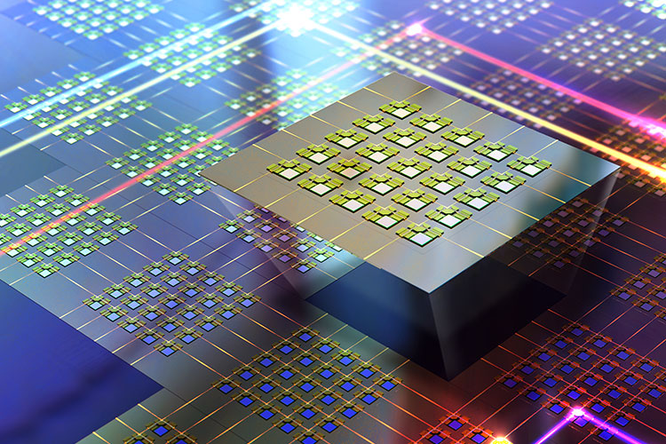 """The photonic switch is built with more than 50,000 microscopic """"light switches"""" etched into a silicon wafer. Each light switch (small raised squares) directs one of 240 tiny beams of light to either make a right turn when the switch is on, or to pass straight through when the switch is off. Image credit: Younghee Lee"""