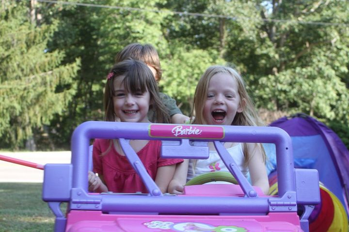 Children in a motorized car. Image credit: CustomKlicks via Wikimedia Commons, CC-BY-SA-4.0