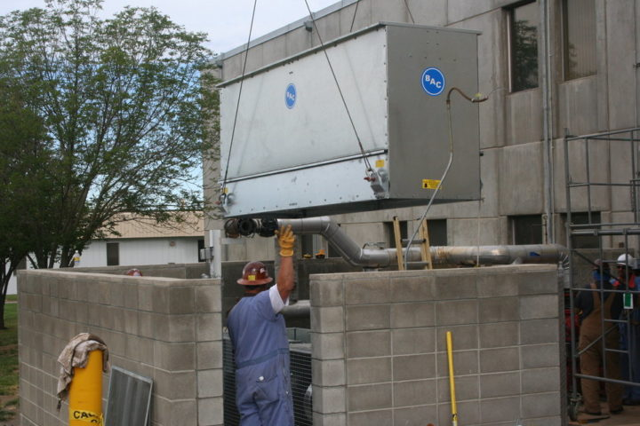 Installation of a new cooling tower system. Image credit: US Department of Energy, Public Domain