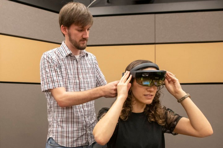 Mark Miller works with lab manager Talia Weiss to run through the experiment during a testing phase. (Image credit: L.A. Cicero, Stanford University)