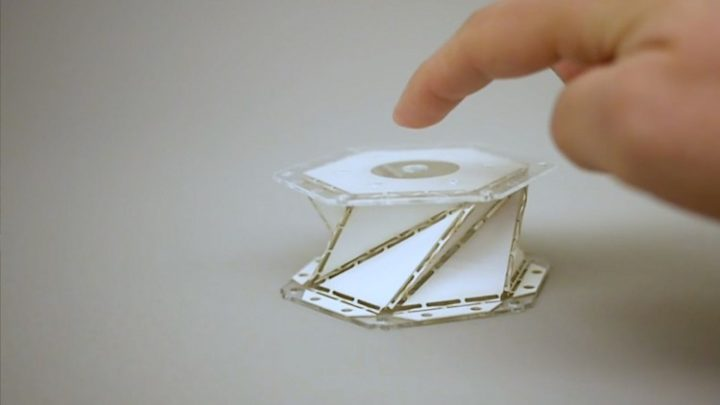 "Inspired by the paper folding art of origami, a University of Washington team created a paper model of a metamaterial that uses ""folding creases"" to soften impact forces for potential applications in spacecraft, cars and beyond. Image credit: Kiyomi Taguchi/University of Washington"