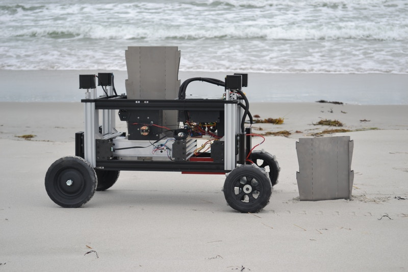 The robot is designed to drive interlocking sheet piles into granular soils like sand on a beach. Image credit: Wyss Institute at Harvard University