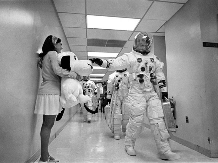 Headed for the launch pad, Apollo 10 Commander Tom Stafford pats the nose of a stuffed Snoopy held by Jamye Flowers (Coplin), astronaut Gordon Cooper's secretary. Credits: NASA