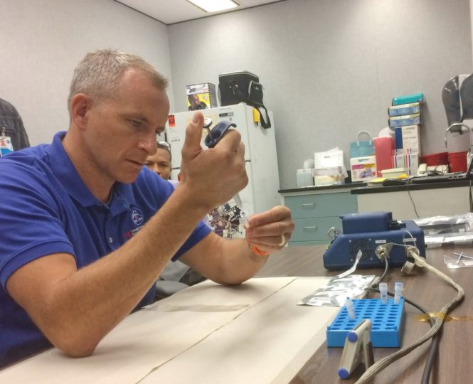 CSA astronaut David Saint-Jacques preparing a sample during pre-flight training at Johnson Space Center. Credits: Canadian Space Agency
